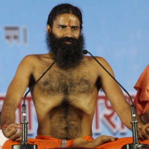 Renowned yoga guru Baba Ramdev performs Yoga exercises before going on a hunger strike with his followers in New Delhi, India, Saturday, June 4, 2011. Ramdev along with tens of thousands of his followers started an indefinite hunger strike in the Indian capital to protest against corruption and what he says is the Indian government's inaction in bringing back black money stashed abroad. (AP Photo)