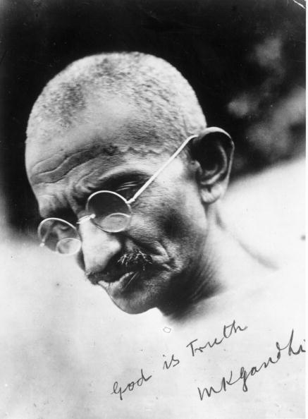 circa 1935:  A signed portrait of Mahatma Gandhi (Mohandas Karamchand Gandhi, 1869 - 1948), leader of the Indian National Congress. He campaigned for tolerance and social reform and an end to discrimination against the so-called untouchable caste. He was assassinated by a Hindu nationalist in the violence that followed the partition of British India into India and Pakistan.  (Photo by General Photographic Agency/Getty Images)