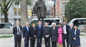 PM in a group photo, after paying homage at the statue of Mahatma Gandhi, outside the UK Parliament, London