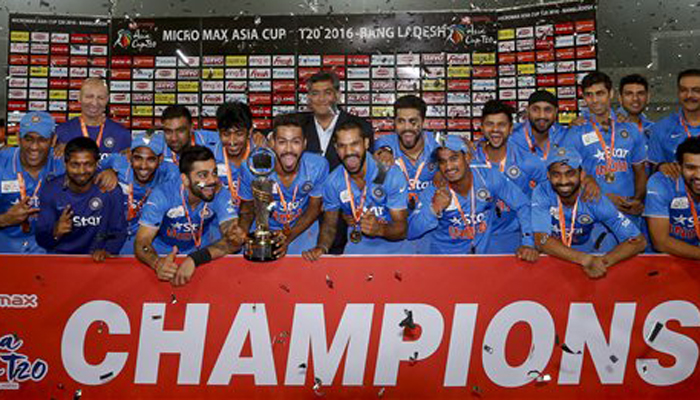 Indian players and support staff pose with the trophy after winning the Asia Cup Twenty20 international cricket final match against Bangladesh in Dhaka, Bangladesh, Sunday, March 6, 2016. India won the Asia Cup for the sixth time after beating host Bangladesh by eight wickets on Sunday.(AP Photo/ A.M. Ahad)