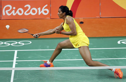 India's V. Sindhu Pusarla returns a shot to Spain's Carolina Marin during the women's badminton singles gold medal match at the 2016 Summer Olympics in Rio de Janeiro, Brazil, Friday, Aug. 19, 2016. (AP Photo/Vincent Thian)