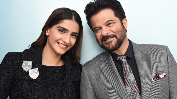 Indian actors Sonam Kapoor and her father Anil Kapoor (right) pose for photographs at the launch of the Indian Film Festival of Melbourne in Melbourne, Friday, Aug. 14, 2015. (AAP Image/Tracey Nearmy) NO ARCHIVING