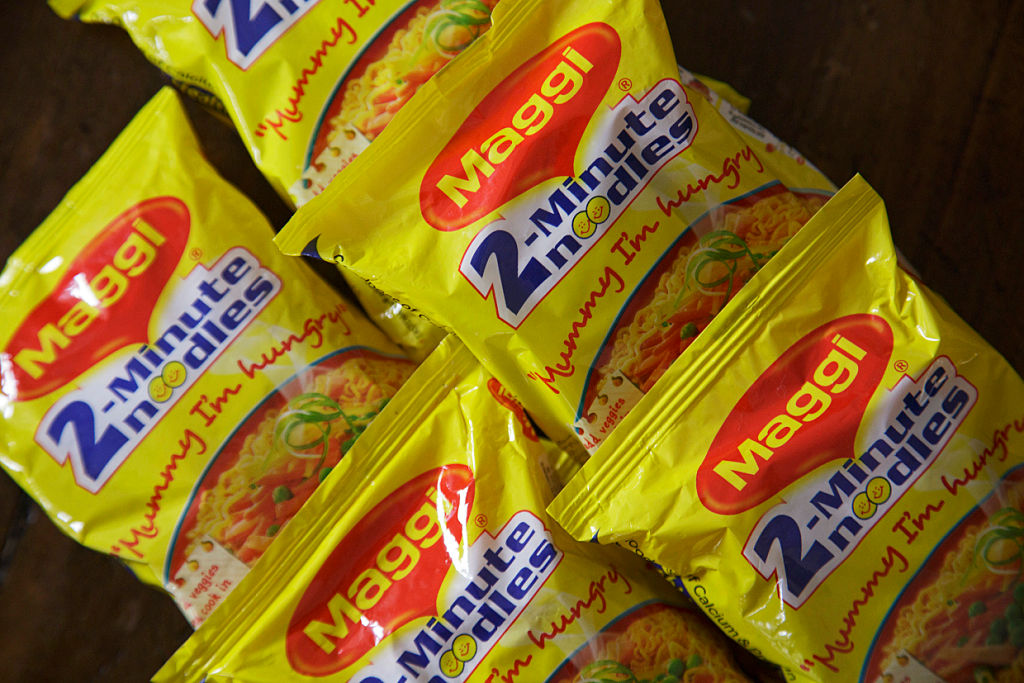 Packets of Maggi 2-Minute Noodles, manufactured by Nestle India Ltd., are arranged for a photograph in New Delhi, India, on Monday, June 15, 2015. Nestle SA said the U.S. Food and Drug Administration is testing samples of imported Maggi noodles after the worlds largest food company halted sales in India when regulators said they contained unhealthy levels of lead. Photographer: Kuni Takahashi/Bloomberg via Getty Images