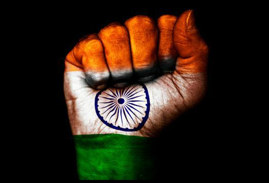 Image of a clenched fist with the flag of india on it.