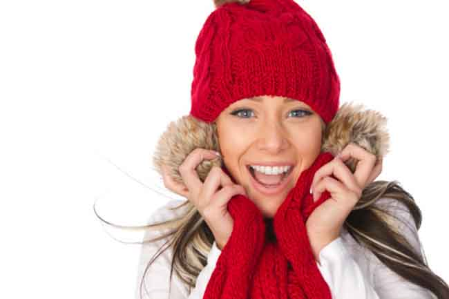 happy young adult in winter clothes