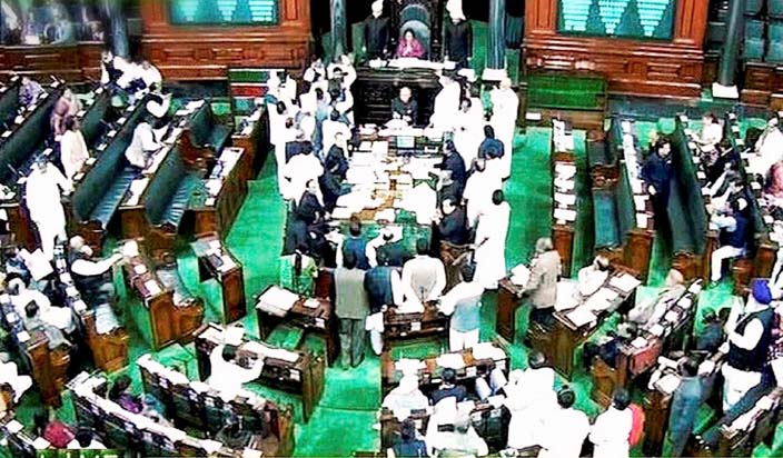New Delhi: A scene of the Lok Sabha during the extended winter session in New Delhi on Friday. PTI Photo / TV GRAB(PTI2_7_2014_000033B)